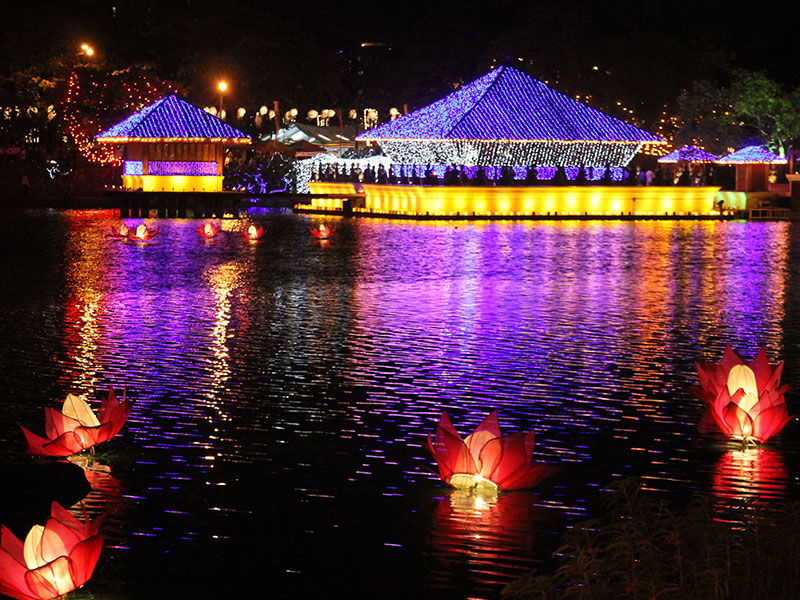 The Beira Lake in Slave Island is lit up at night for a week in May to celebrate three milestones in the life of the Lord Buddha. Photo by Noreyana Fernando