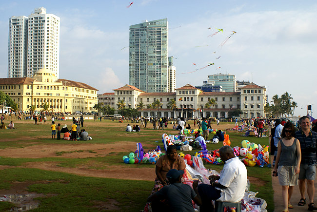 Tourists, locals and vendors embrace the gentle salty breeze at the Galle Face Green, easily the most popular family  entertainment destination. Photo courtesy of MooreTravelTips.com.