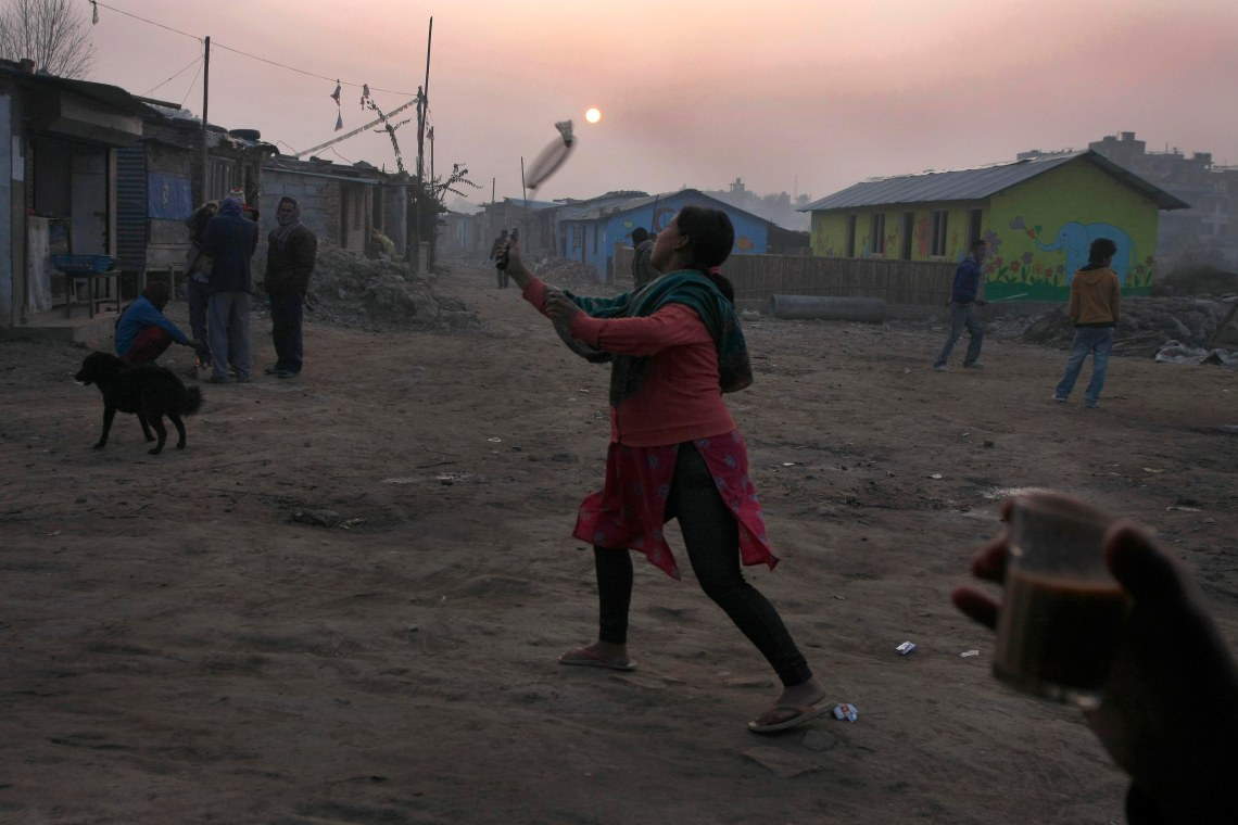 A young pregnant woman plays badminton early in the morning. She is living in her maternal house at squatter area. Her newly married husband has gone to Saudi Arabia for work.