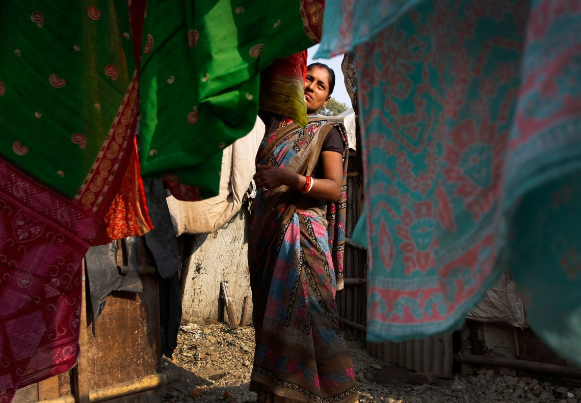 Radha Choudhary, drying clothes. She is originally from Madhuban, Koshi. After a flood in Koshi swept her house and land, her family migrated to several parts of the country, before ending up in Kathmandu.