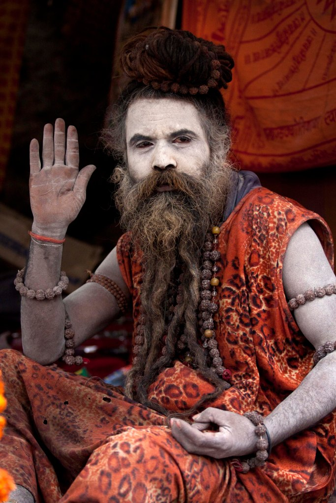 A sadhu extends his blessing to visitors during Shivaratri.