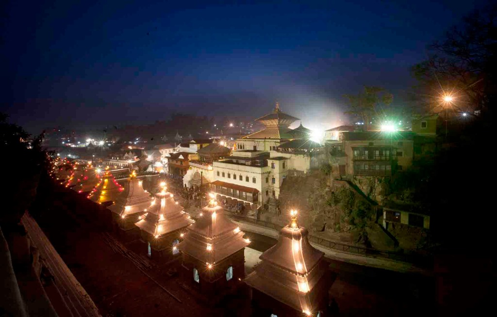 An illuminated view of the Pashupati temple premise during Shivaratri.